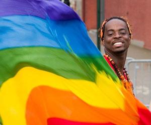 Gay-man-with-rainbow-flag